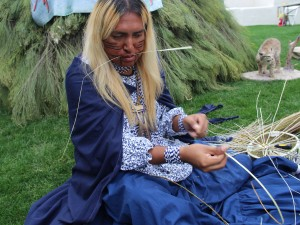 Timothy Ward. Jr, 30, weaves a traditional Apache burden basket at Arizona Indian Festival at Scottsdale Civic Park in January. (Photo by Carina Dominguez/News21)