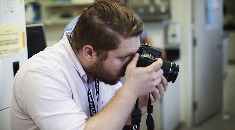 Jayson Chesler snaps a photo in the University of Arizona's College of Medicine where researchers in the pharmacology department examine medical benefits of cannabidiol.  (Photo by Alexa Ard/News21)