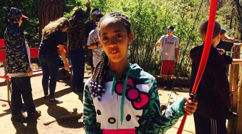 Mercedes Gonzales learns about archery at Camp Candlelight in Prescott, Arizona. Gonzales was the first child to openly use cannabis oil at the camp. (Photo courtesy of Yolanda Daniels)