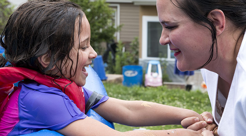 Lolly Bentch Myers plays with her daughter Anna, 5, near the pool by their home in Harrisburg, Pennsylvania. Bentch Myers leads the organization Campaign for Compassion, which advocates for  legalized medical use of cannabis. (Photo by Calah Kelley/News21)