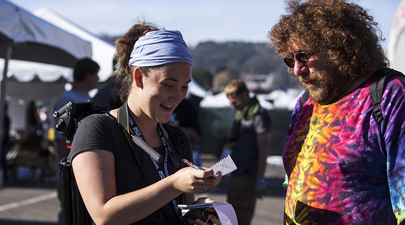 "Kelcie Johnson interviews Todd Schriger, who calls himself the ""Bubble Man,"" at the 2015 High Times NorCal Medical Cannabis Cup in Daly, California. (Photo by Sean Logan/News21)"