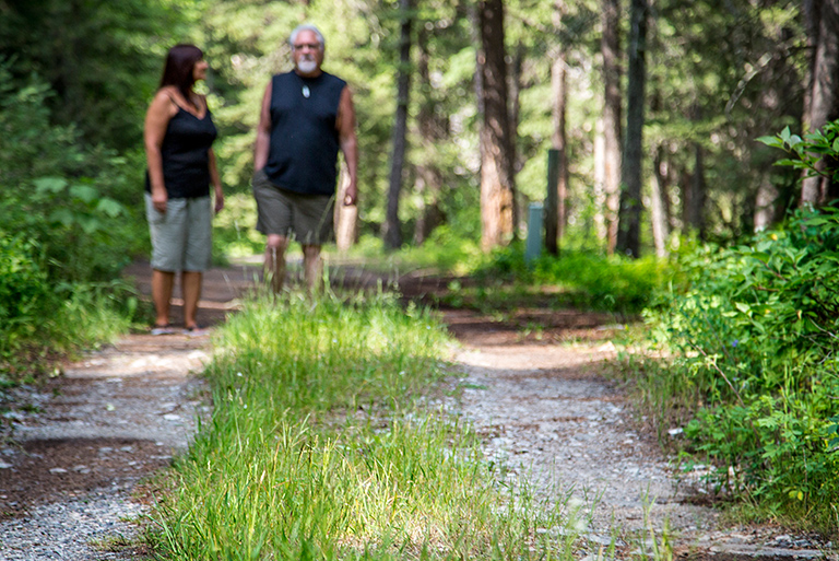 Mark and Valerie Sigler walk in the woods surrounding their home outside Bozeman, Montana. The Siglers owned and operated a number of medical marijuana dispensaries until they were shut down by federal authorities in 2011.